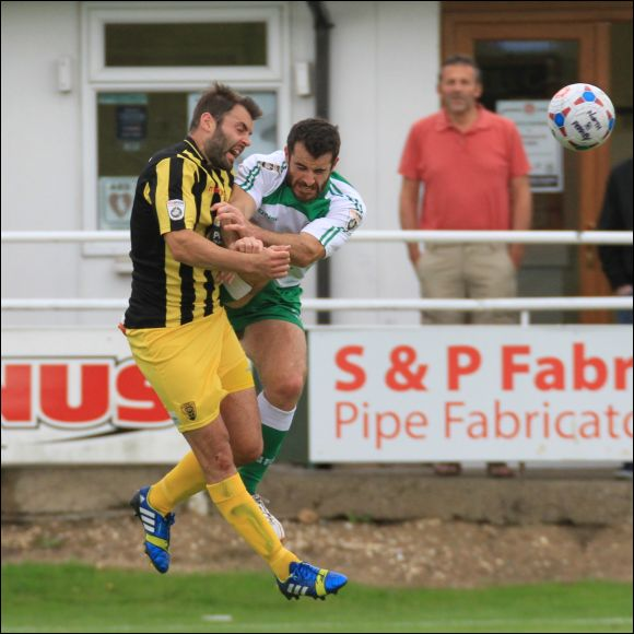 Ferriby player Adam Boulder is red carded for this high challenge