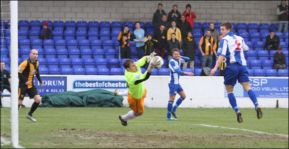 Chester keeper John Danby saves a header from Darren Edwards