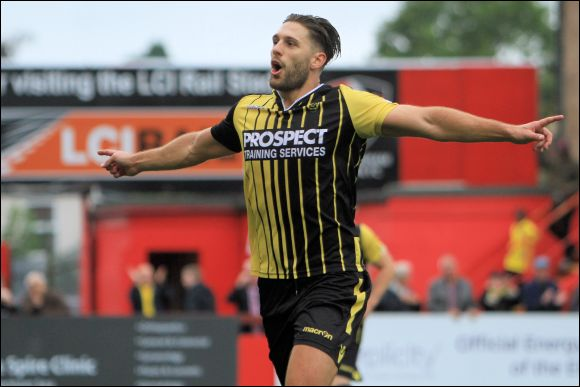 Luke Hopper celebrates the second of his hattrick goals against Altrincham
